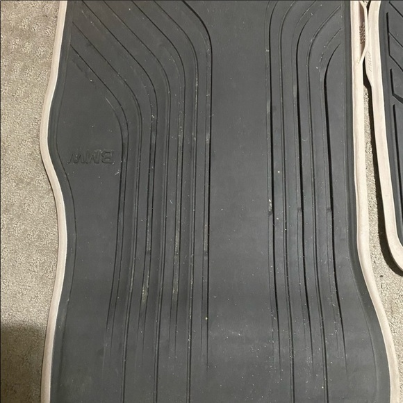 BMW brown and black on bottom side rubber mats